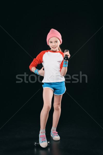 Lány képzés súlyzók izolált fekete tevékenységek Stock fotó © LightFieldStudios