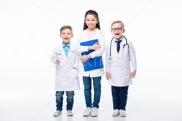 Crianças brincando médicos três sorridente crianças médico Foto stock © LightFieldStudios