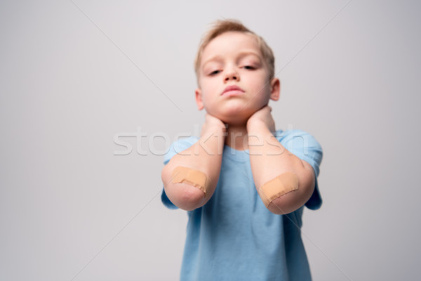 Little boy with patches on elbows  Stock photo © LightFieldStudios
