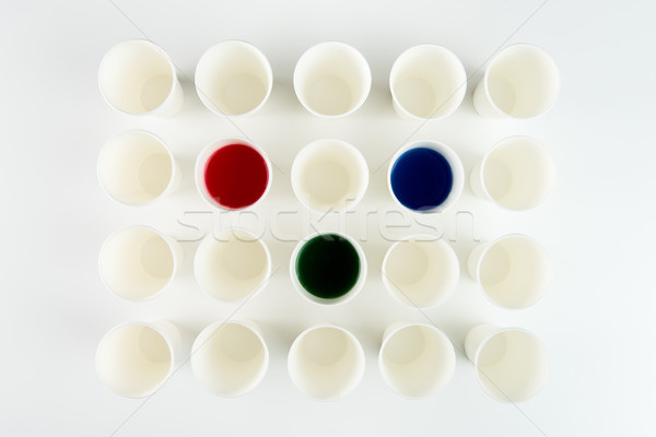 Top view of set of empty plastic cups and cups with red, green and blue paints   Stock photo © LightFieldStudios
