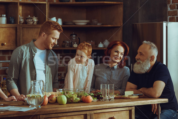 family cooking dinner at home Stock photo © LightFieldStudios