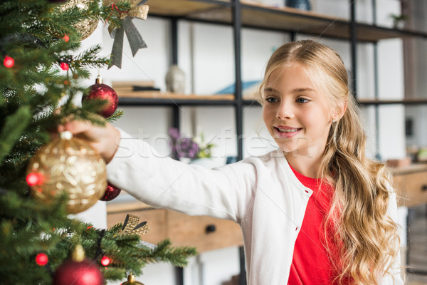 kid decorating christmas tree Stock photo © LightFieldStudios
