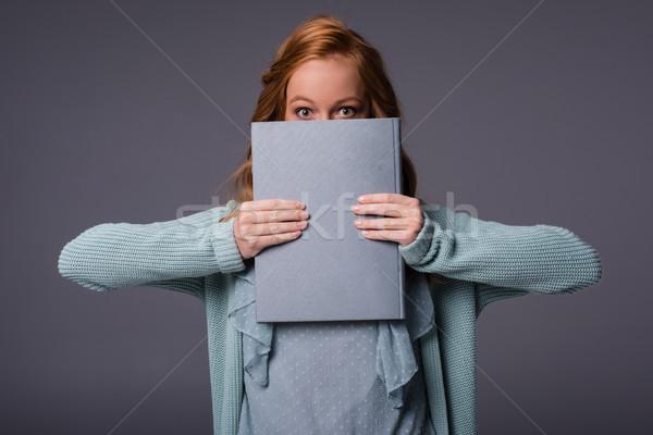 girl holding book Stock photo © LightFieldStudios