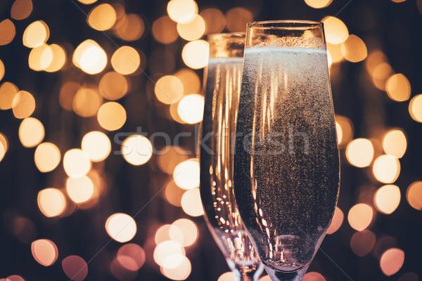 Szemüveg pezsgő buborékok közelkép kilátás ünnepi Stock fotó © LightFieldStudios