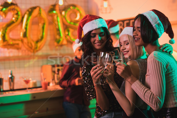 multicultural women with glasses of champagne Stock photo © LightFieldStudios