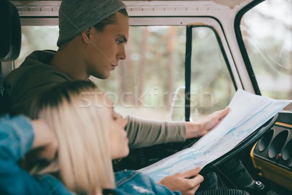 couple of travelers with map in minivan Stock photo © LightFieldStudios