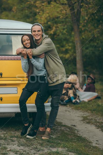 happy interracial couple Stock photo © LightFieldStudios