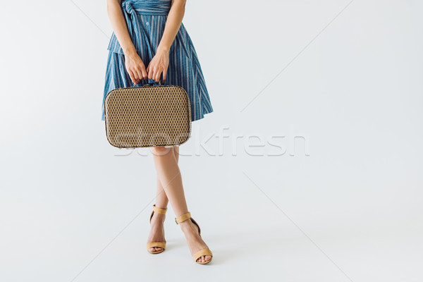 Stock photo: woman holding suitcase