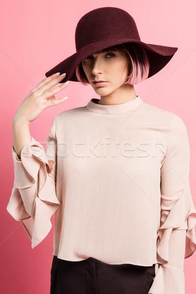 Attractive woman in wide-brimmed hat Stock photo © LightFieldStudios