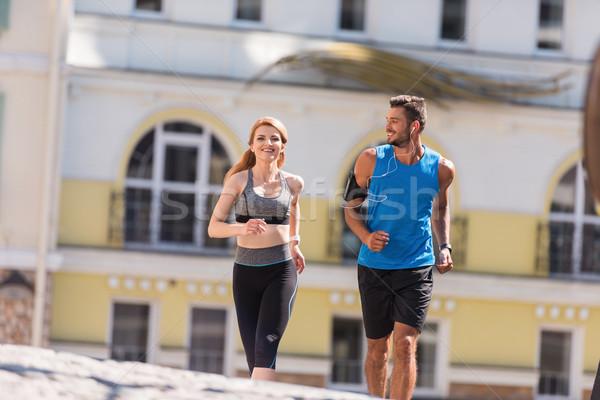sport couple jogging in city Stock photo © LightFieldStudios