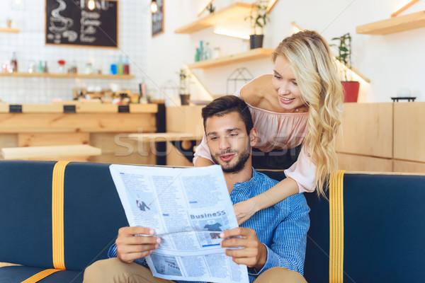 couple reading newspaper Stock photo © LightFieldStudios