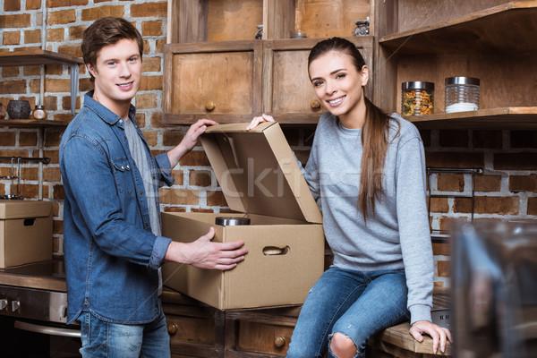couple unpacking cardboard box Stock photo © LightFieldStudios