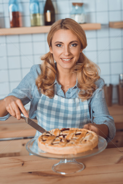 waitress cutting pie Stock photo © LightFieldStudios