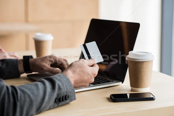 man making e-shopping with laptop Stock photo © LightFieldStudios