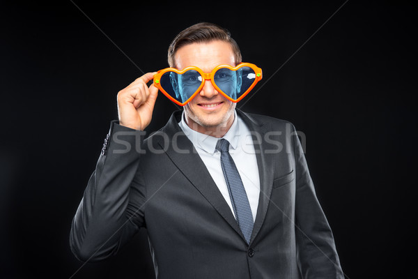Man in heart shaped glasses Stock photo © LightFieldStudios