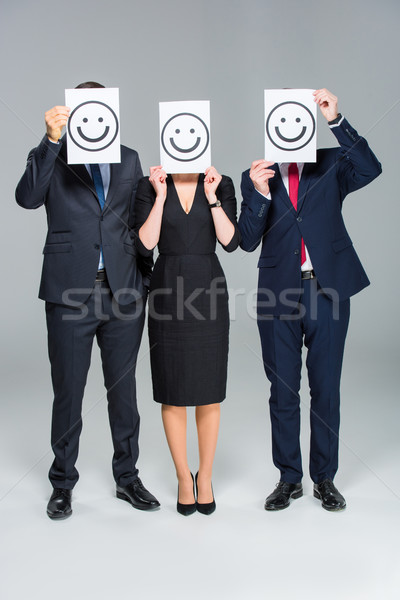 Businesspeople holding cards Stock photo © LightFieldStudios