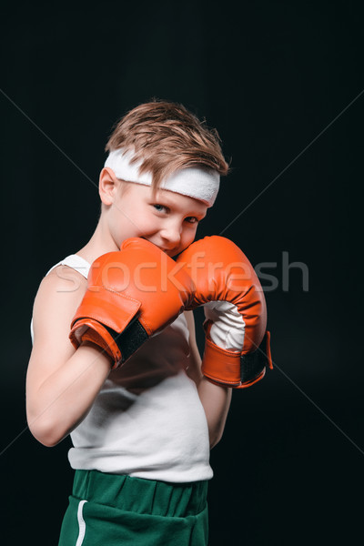portrait of smiling boy in boxing gloves isolated on black, active kids concept Stock photo © LightFieldStudios