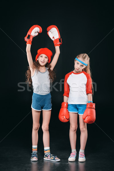 sportive girls in boxing gloves isolated on black, active kids concept Stock photo © LightFieldStudios