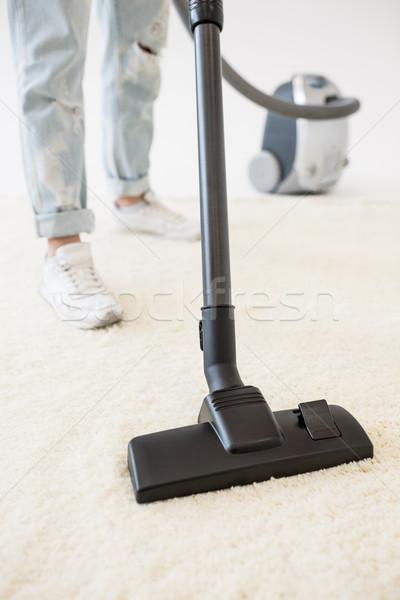 Woman vacuuming carpet Stock photo © LightFieldStudios