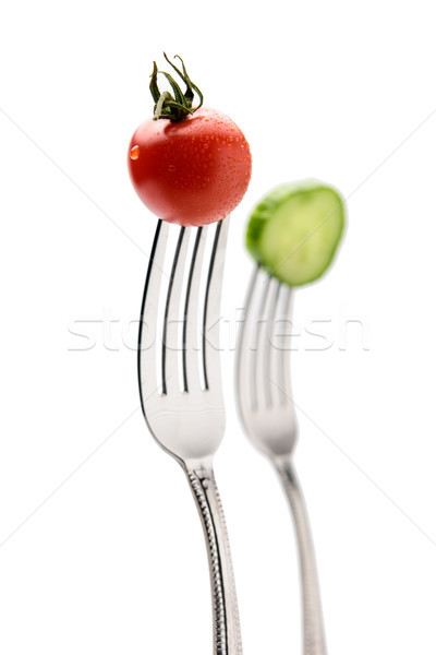 cucumber and cherry tomatoe on forks isolated on white. healthy lifestyle concept Stock photo © LightFieldStudios