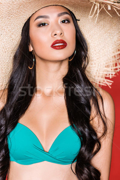 Stock photo: Woman in swimsuit and beach hat