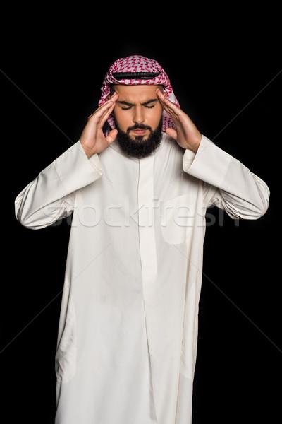 muslim man with headache Stock photo © LightFieldStudios