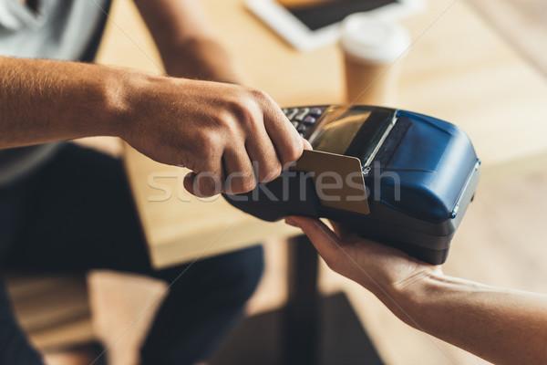 man paying with credit card Stock photo © LightFieldStudios
