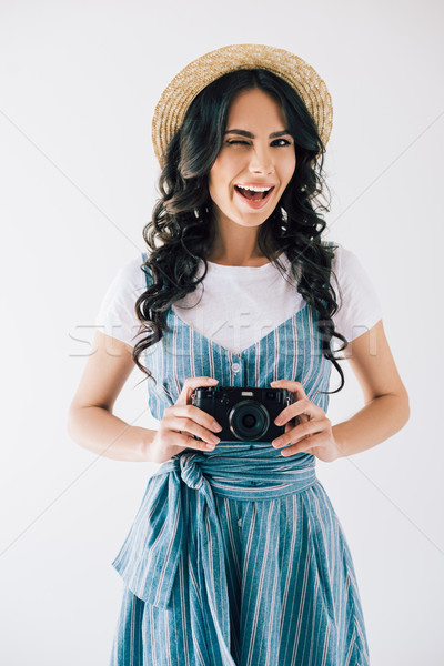 winking woman with photo camera in hands Stock photo © LightFieldStudios