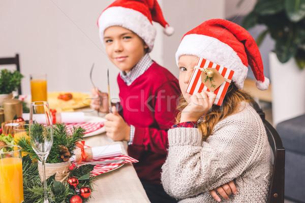 Frère soeur séance Noël table adorable Photo stock © LightFieldStudios