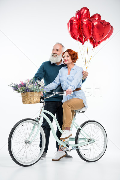 Mature couple with bicycle  Stock photo © LightFieldStudios