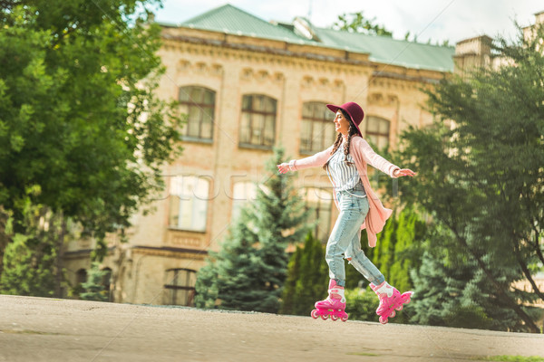 Stock photo: stylish girl in roller skates
