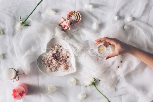 female hand holding small candle Stock photo © LightFieldStudios