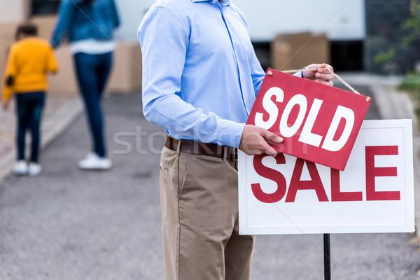 realtor hanging sold sign Stock photo © LightFieldStudios