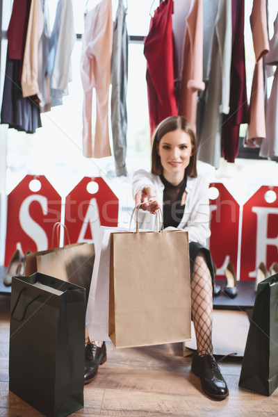 shopaholic with shopping bags Stock photo © LightFieldStudios