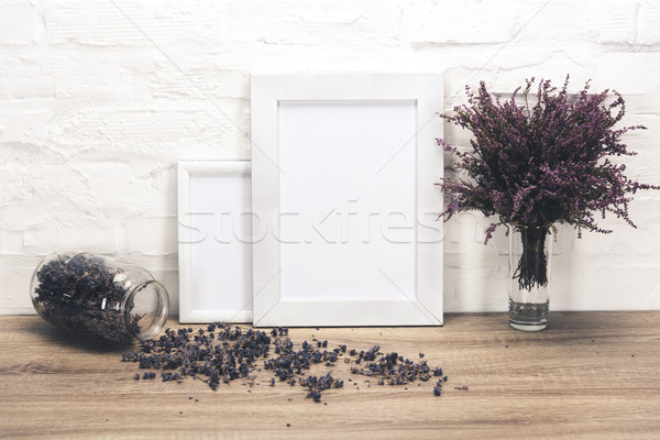 empty photo frames and flowers on table Stock photo © LightFieldStudios