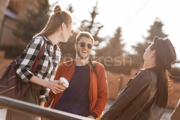 smiling friends on street Stock photo © LightFieldStudios
