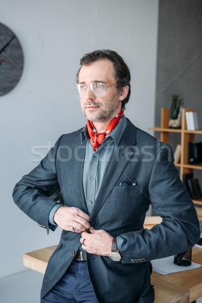 Affaires costume veste élégant lunettes Photo stock © LightFieldStudios