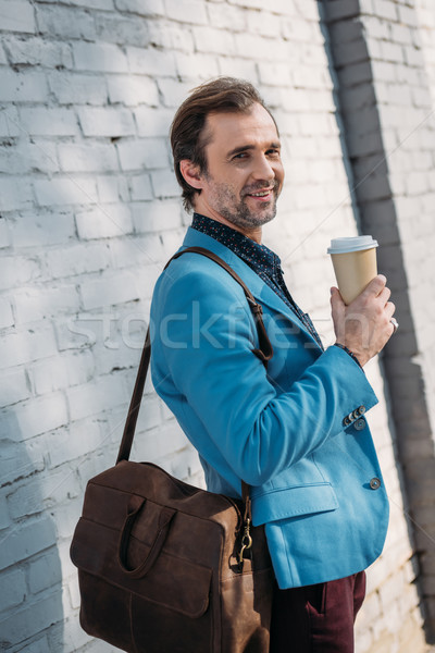 stylish man with coffee to go Stock photo © LightFieldStudios