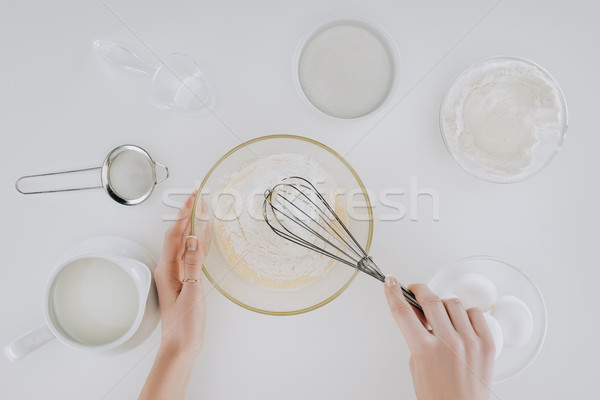 cropped shot of person whisking dough while cooking pancakes isolated on grey Stock photo © LightFieldStudios