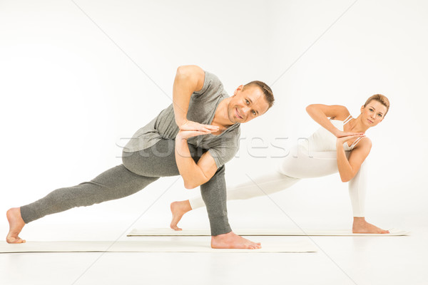 Couple practicing yoga Stock photo © LightFieldStudios