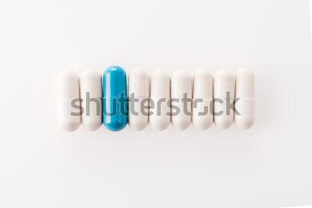 Felső kilátás orvosi kapszulák csetepaté fehér Stock fotó © LightFieldStudios