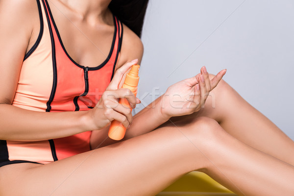 woman applying sunscreen on hand Stock photo © LightFieldStudios