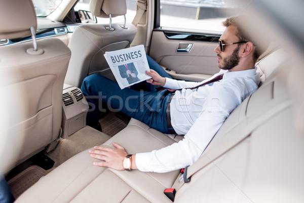 üzletember üzlet újság fiatal elegáns napszemüveg Stock fotó © LightFieldStudios