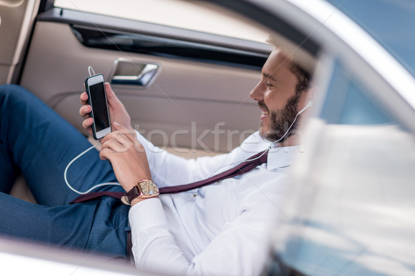 man listening music in car Stock photo © LightFieldStudios