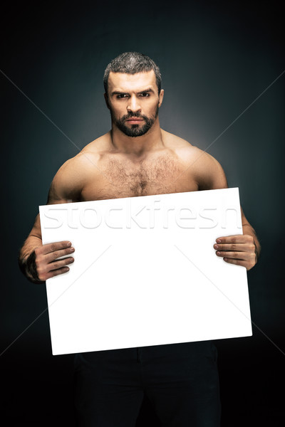 athletic man with blank banner Stock photo © LightFieldStudios