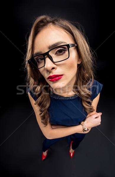 Attractive businesswoman in eyeglasses Stock photo © LightFieldStudios
