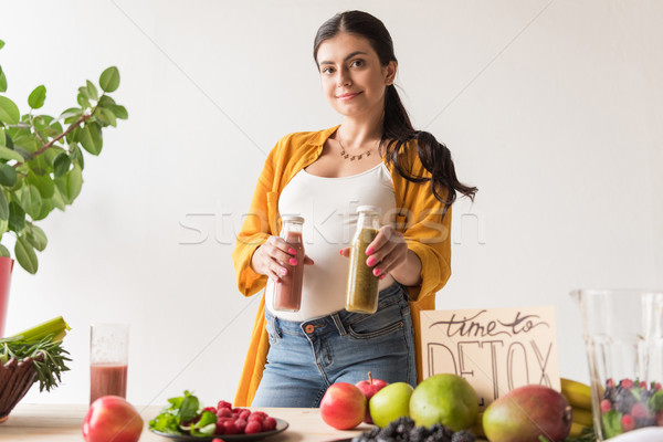 Stock photo: pregnant woman with detox drinks
