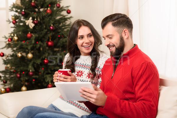 couple using digital tablet Stock photo © LightFieldStudios