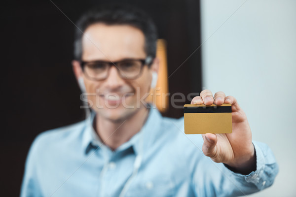 Stock photo: businessman holding credit card