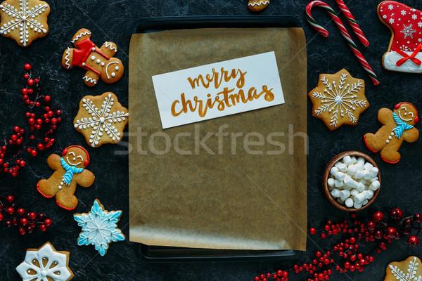 Karácsonyi üdvözlet sütés tálca felső kilátás házi készítésű Stock fotó © LightFieldStudios